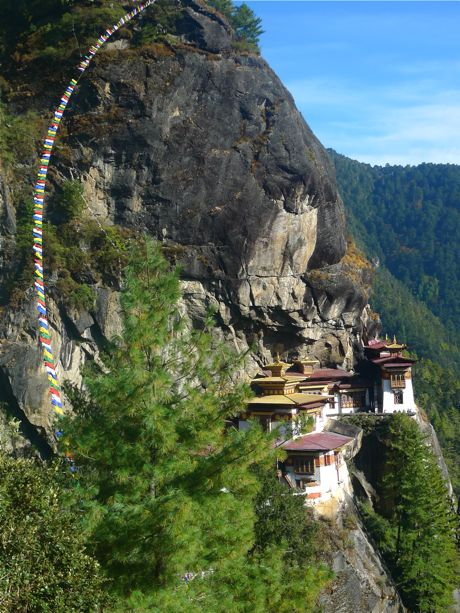 Taktsang monastery, rebuilt after a devastating fire in 1998. The temple structure surrounds the sacred cave where Guru Rinpoche meditated for 3 years, 3 months and 3 days after arriving from Tibet on the back of a flying tiger.