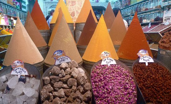 """At Abdul's spice stall,you can find uncommon ingredients such as rosebuds, alum and benzoin. The tall cones, made of paper, coated with glue and dusted with ground spices such as cumin, paprika and turmeric, tell passers-by, """"Spices are sold here."""""""
