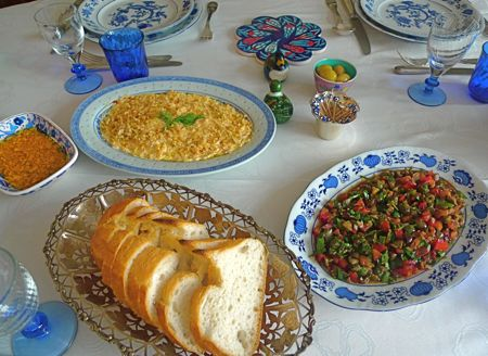 At Selin's table, the mezze or cold starters, include a peppery cheese from Antakya, carrot salad dressed with yogurt, and the green olive salad with pomegranate molasses.