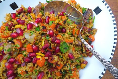 Winter tabbouleh salad, full of roasted vegetables and fresh herbs, is sassy enough to banish the winter blahs. Pomegranate molasses adds zing, while the ruby seeds glow like jewels and add their own luscious, fruity flavor.